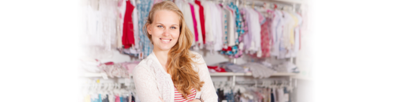 Smiling Retail Clothing Shop Owner