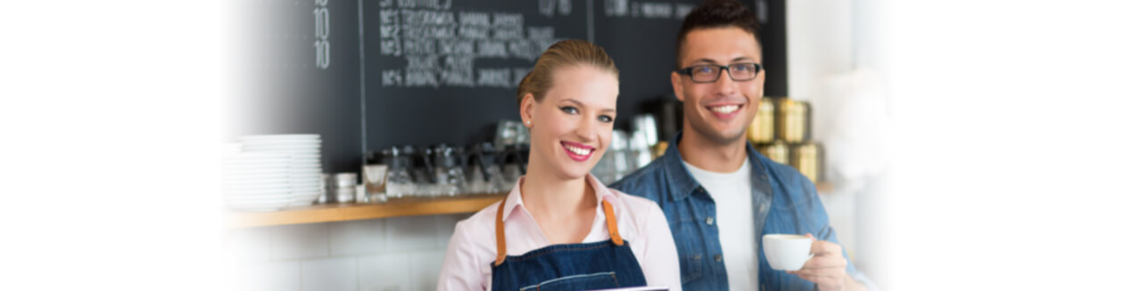 Smiling Pair of Coffee Shop Owners