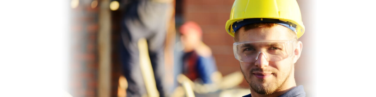 Man in yellow hardhat at construction site